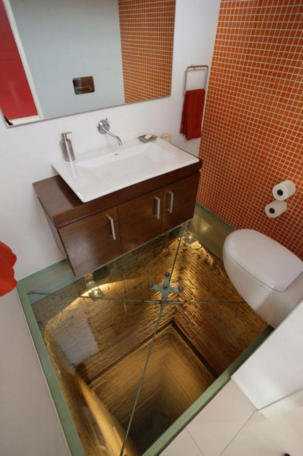 Glass floor and an open shaft to make your bathroom scary