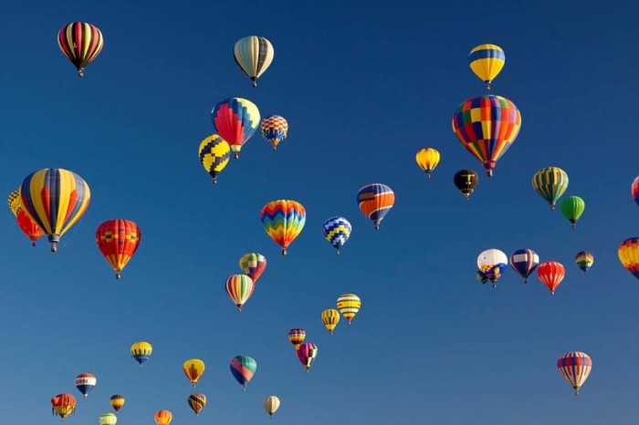 many-vividly-colored-hot-air-balloons-ralph-lee-hopkins