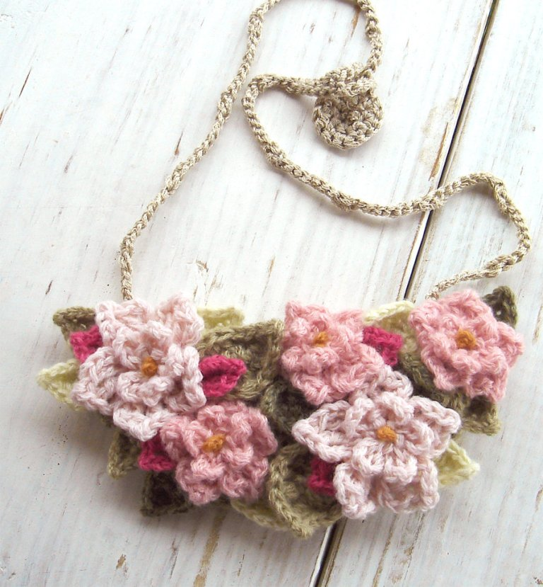 crochet_bib_necklace_in_soft_pink_flowers_by_meekssandygirl-d4kln8k