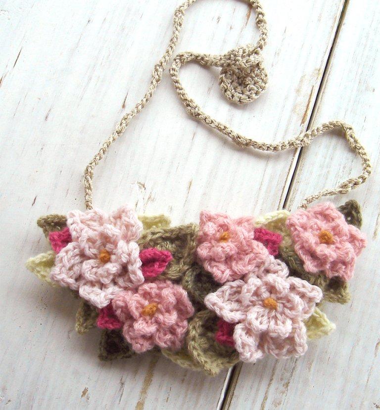 crochet_bib_necklace_in_soft_pink_flowers_by_meekssandygirl-d4kln8k