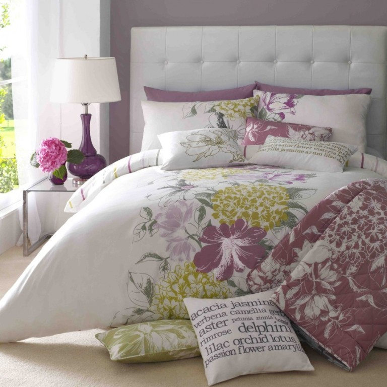 Fascinating-Floral-Print-Duvet-Cover-Set-on-Lavish-White-Bed-Small-Glass-Bedside-Table-with-Purple-Table-Lamp-Tufted-Bed-Headboard-906x906