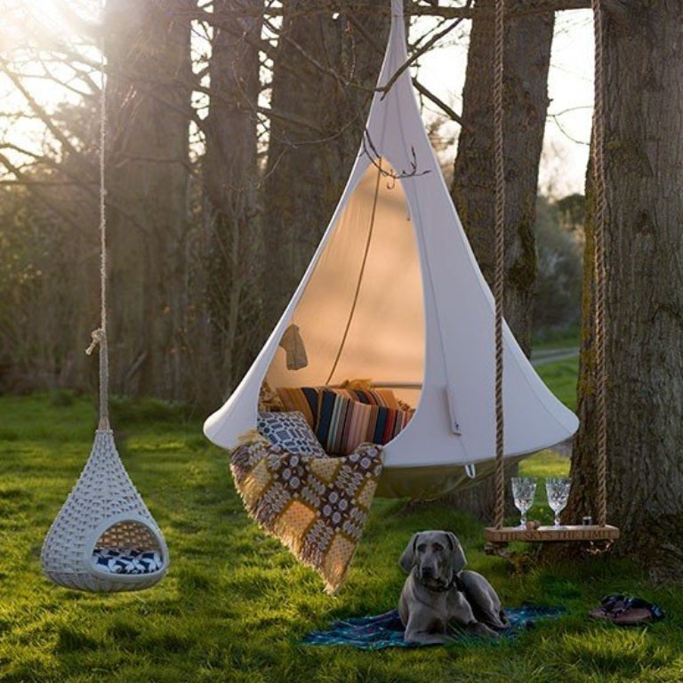 Hanging Cacoon Hammock Chair that works as a hammock chair and a hanging tent which make it perfect for camping or even relaxing at your home, backyard, garden or any other place in which you can hang it.