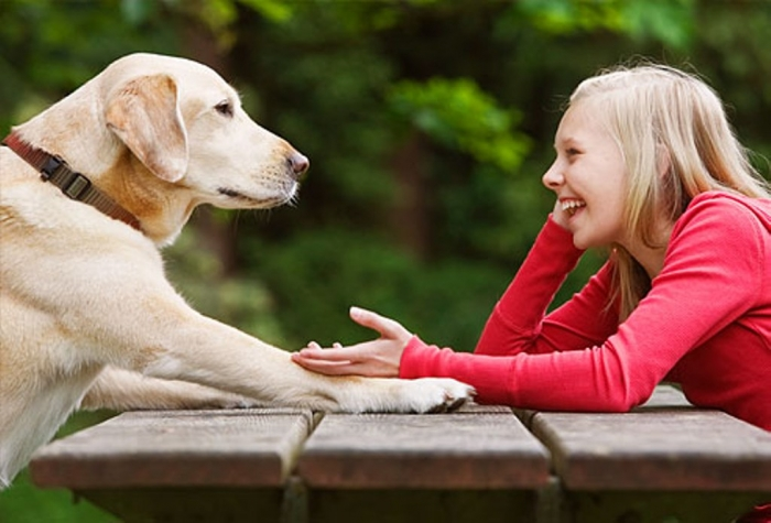 getty_rf_photo_of_girl_relaxing_while_talking_to_dog