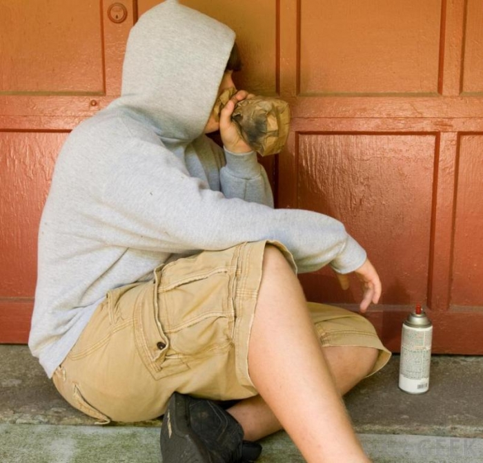 man-in-sweatshirt-huffing