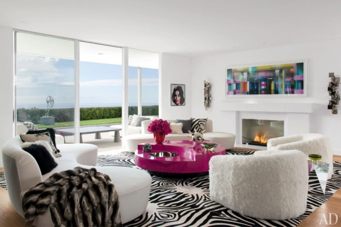 suzy-q-better-decorating-bible-blog-zebra-rug-white-walls-green-sofa-pink-coffee-table-color-blocking-bold