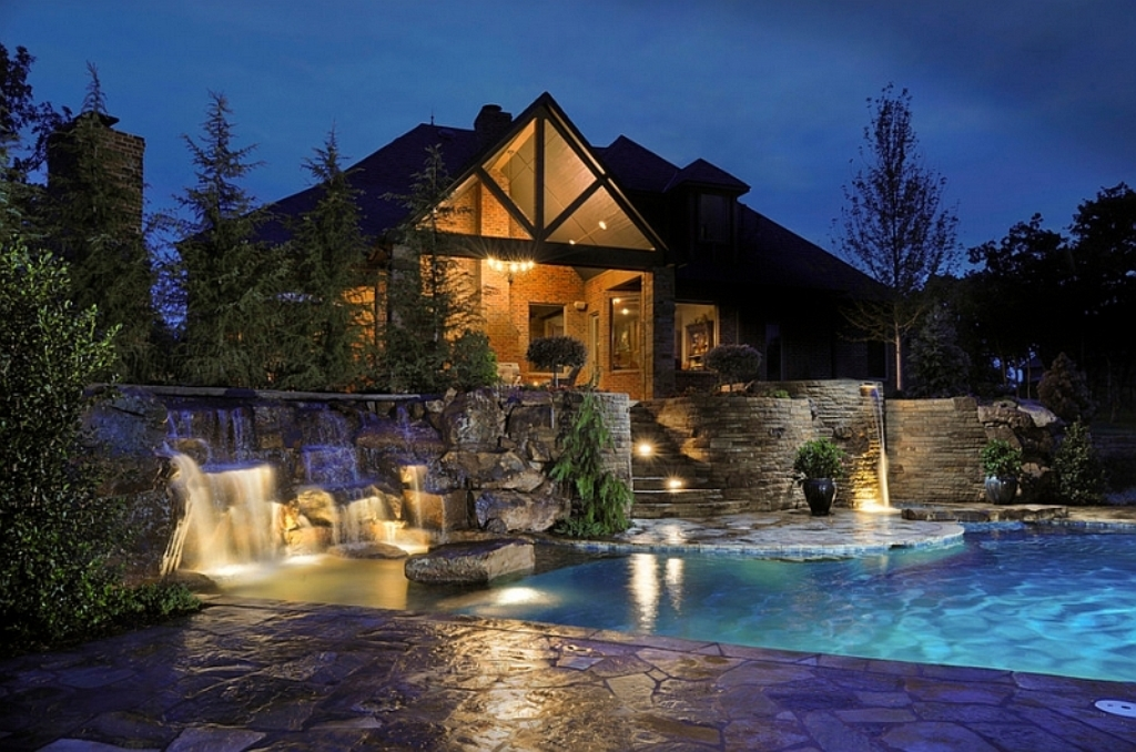 Elaborate-swimming-pool-with-multi-level-waterfalls-and-patios