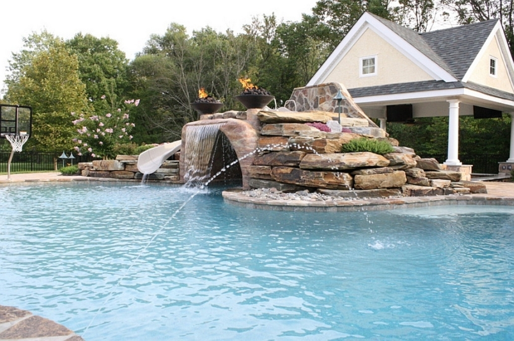 Expansive-pool-with-a-water-slide-waterfall-feature-and-water-jets
