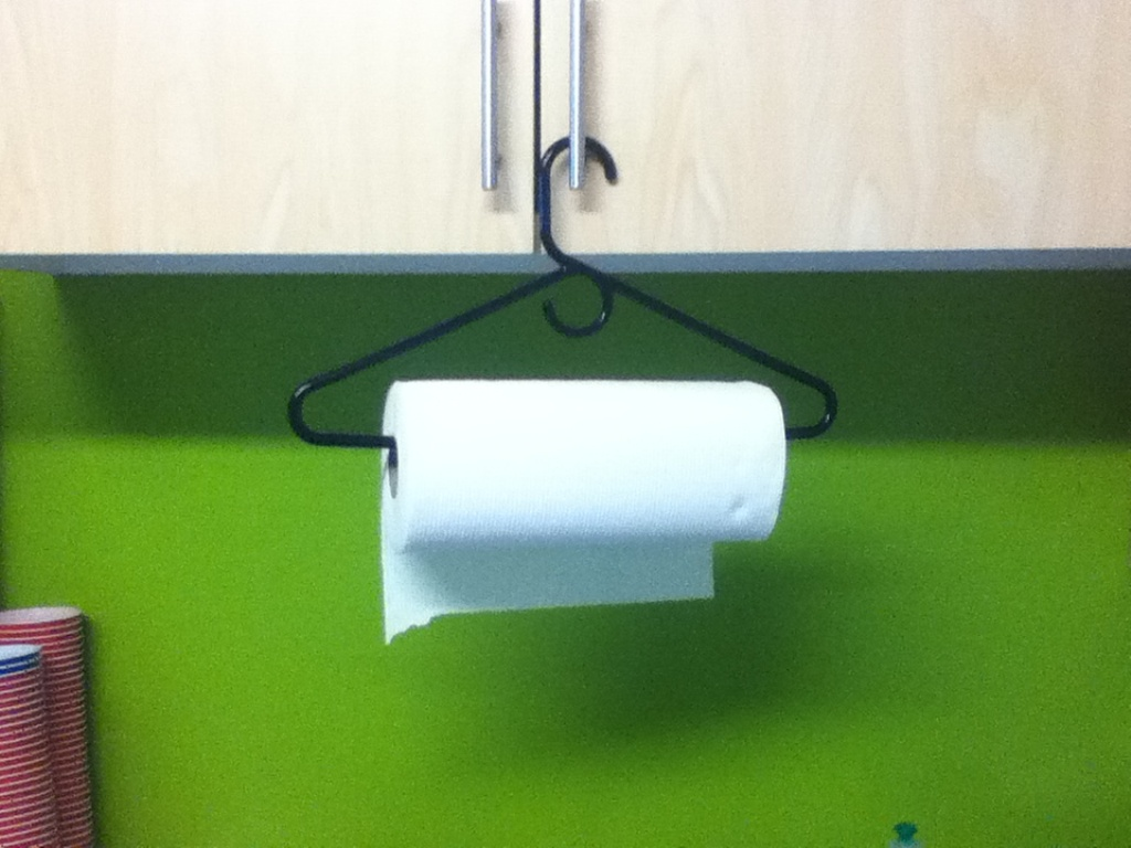 If you do not have a paper towel holder, then you can easily create a new one through using a hanger