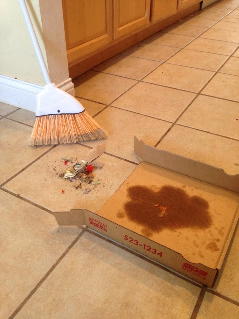 Instead of throwing the pizza box, use it as a dust pan or plates