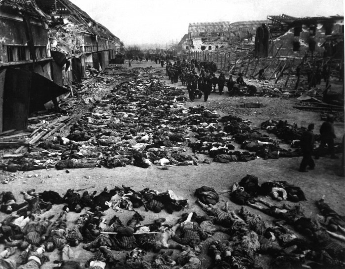 Rows_of_bodies_of_dead_inmates_fill_the_yard_of_Lager_Nordhausen,_a_Gestapo_concentration_camp
