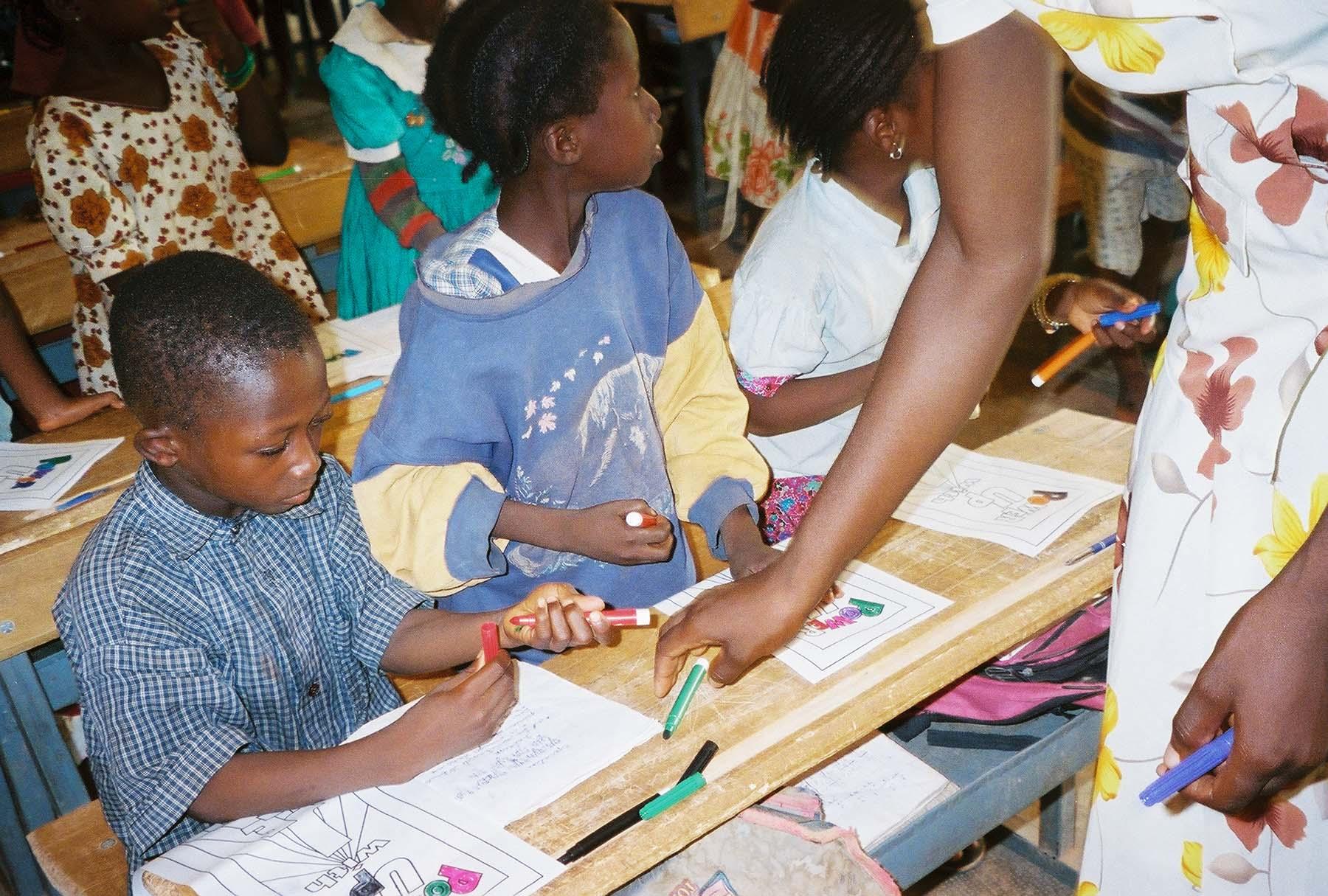 Kids in classroom with teacher