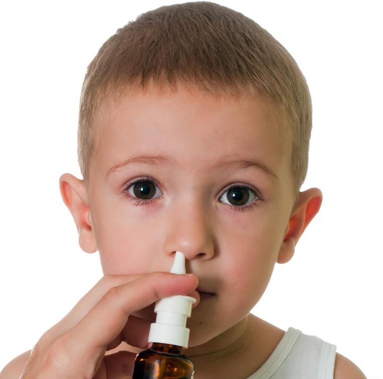 boy-with-nasal-spray-against-white-background