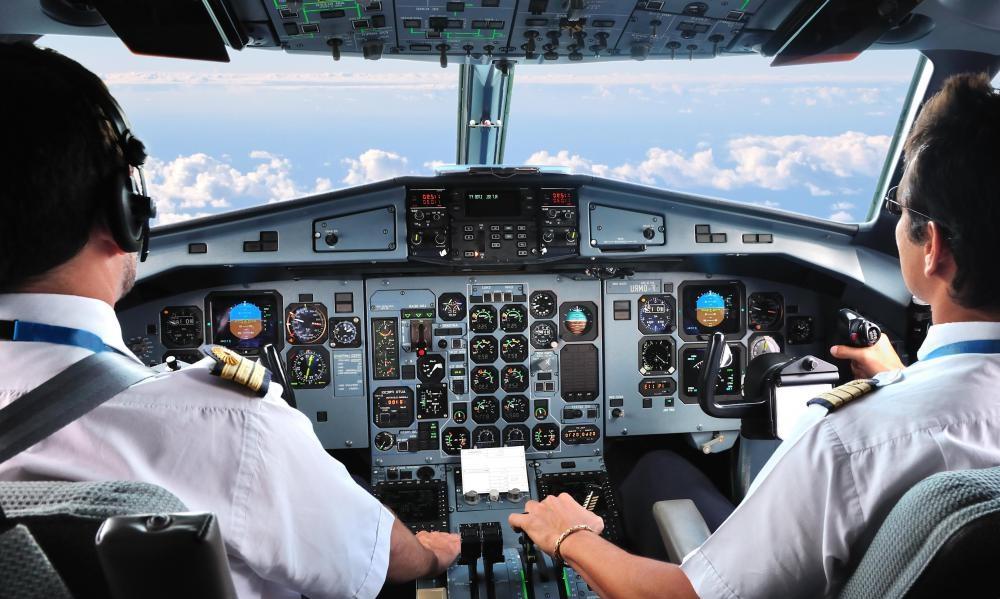 pilots-sit-behind-older-cockpit
