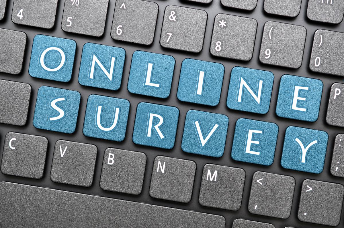 Blue online survey key on keyboard