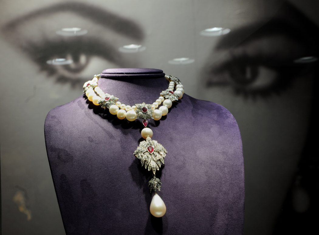 """""""La Peregrina"""", a Cartier pearl, diamond and ruby necklace owned by US actress Elizabeth Taylor on display during a preview of The Collection of Elizabeth Taylor December 1, 2011 at Christie's in New York. The jewelry in Taylor's collection will go on sale December 13, this necklace is estimated at USD 2 million to 3 million. AFP PHOTO/Stan HONDA (Photo credit should read STAN HONDA/AFP/Getty Images)"""