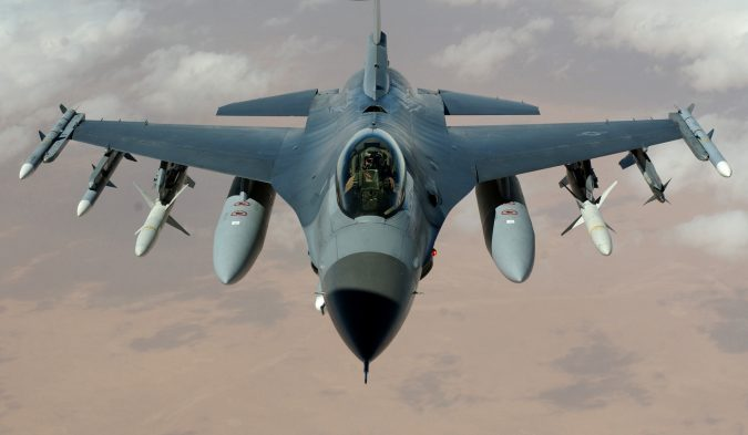 """OPERATION IRAQI FREEDOM -- An F-16 Fighting Falcon flies a mission in the skies near Iraq on March 22. The F-16s are from the 35th Fighter Wing """"Wild Weasels"""", Misawa Air Base, Japan. (U.S. Air Force photo by Staff Sgt. Cherie A. Thurlby)"""