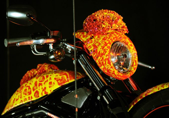 """Artist Jack Armstrong's """"Cosmic Starship"""" Harley Davidson is unveiled on October 21, 2010 in Marina Del Rey, California. Priced at USD one million, this is the world's first and only million dollar Harley. Armstrong was a protege of Andy Warhol and his paintings retail for 300K to 2M USD. AFP PHOTO / GABRIEL BOUYS"""