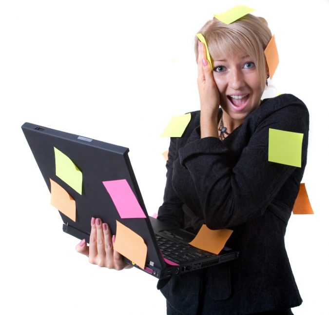 Businesswoman with notebook and reminding notes