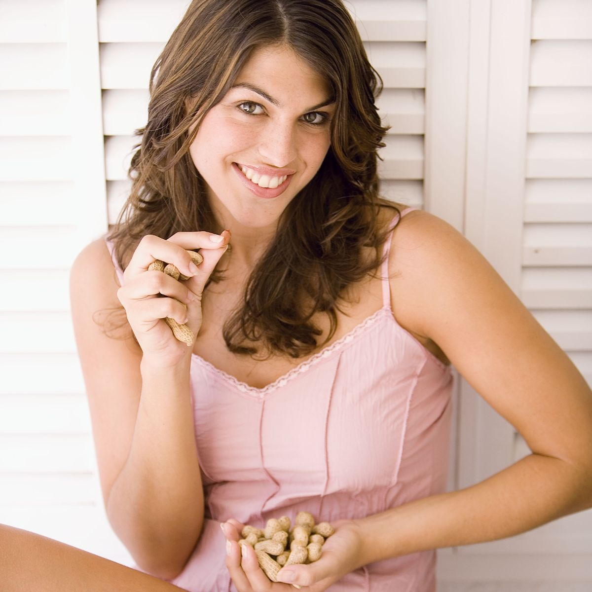 Woman eating peanuts